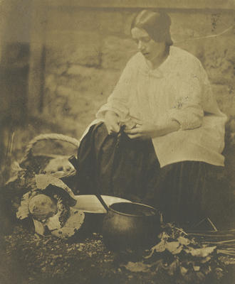 Woman peeling vegetables