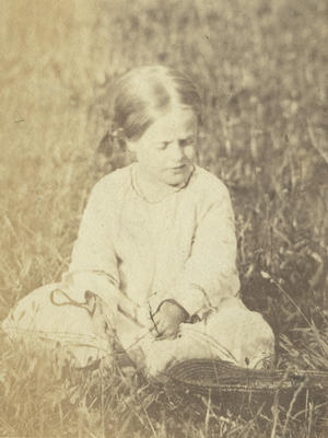 Girl seated in a field